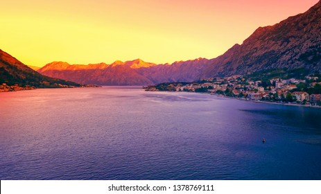 City of Kotor, Montenegro as the sun rises over the Bay of Kotor in the Adriatic Sea
