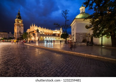 City of Krakow by night in Poland, Main Square in the Old Town with Church of St. Adalbert (St. Wojciech), Cloth Hall (Sukiennice) and Town Hall tower.