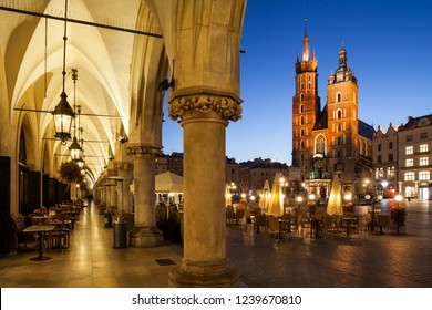 City of Krakow by night in Poland, Main Square in the Old Town with St. Mary Church from the arcade of the Coth Hall (Sukiennice).