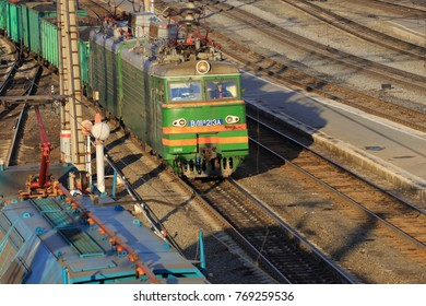 The city of Kurgan, Rosia, April 3, 2014: The cargo locomotive VL-213A carries coal at the Kurgan station. A large freight station in Western Siberia.