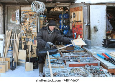 City of Kurgan, Russia, January 12, 2013: Metalware trading. A man in a frosty day puts the goods on the market.