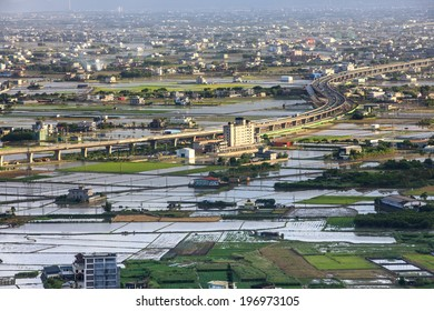 A city with land divided into waterways and farmland.
