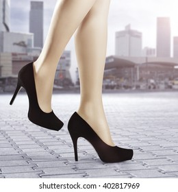 city landscape and black heels and street