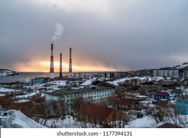 City landscape of residential area of Petropavlovsk-Kamchatsky in the evening at sunset in winter with a view of the bay