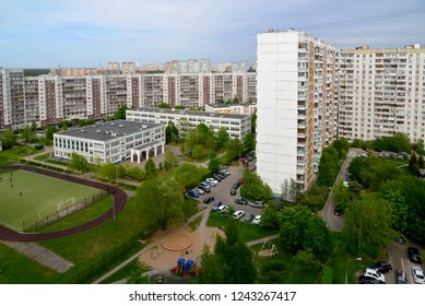 City landscape with school and football field in summer in Moscow, Russia