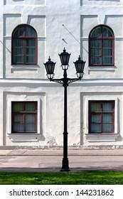 City lantern on the background wall of the palace. Riga. Latvia