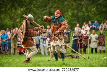 "City at Latvia - Rezekne, July 30, 2016: Celebration ""Medieval Event Reconstruction"". Military competitions, wall-to-wall fights, a tournaments. People are dressed in medieval clothes."