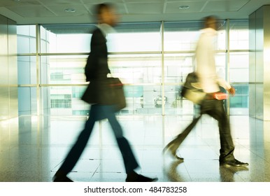 City life, blurred people walking on the airport