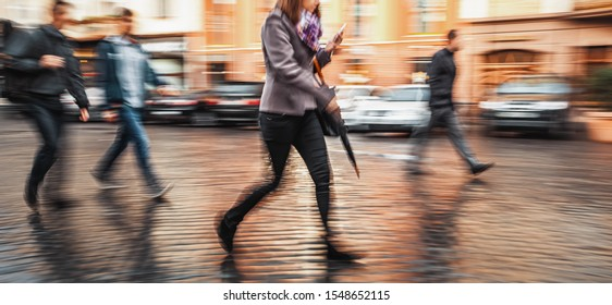 City life concept. People rushing in city. Abstract street scene in motion blur.