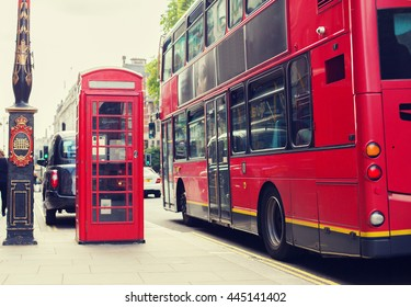 city life and public places concept - red double decker bus and telephone booth on london street