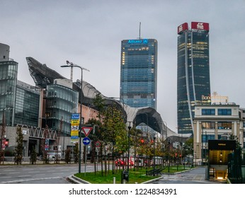 City Life Skyscrapers in Morning Light with Traffic and Wet Asphalt after Days of Rain in Milan,Italy-November 2018