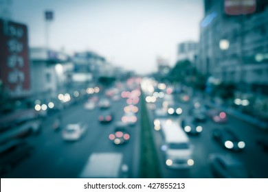 City life, traffic in evening blurred and dark tone with bokeh light