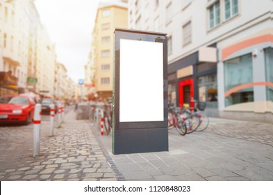 City light, video led billboard mockup on street. Cars in background.