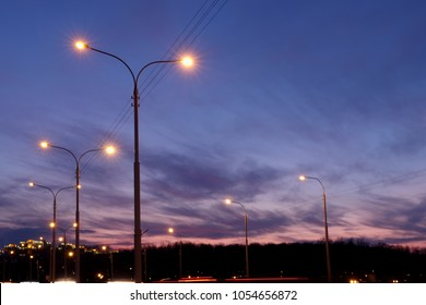 city lighting poles off the road, evening landscape
