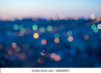 city lights abstract circular bokeh on blue background