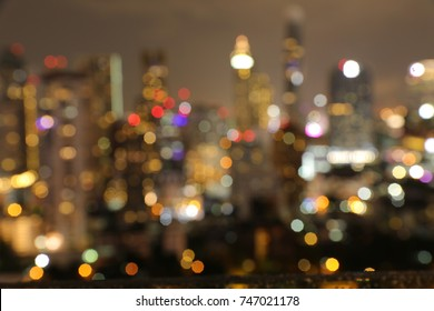 City lights abstract circular bokeh. Abstract bokeh cityscape night light background. Urban city night light bokeh , defocused background.