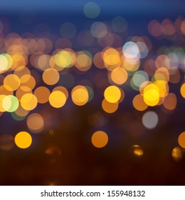 city lights in the background with blurring lights