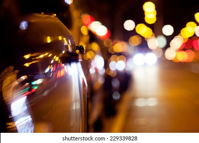 City lights. Background with blurring lights on the road