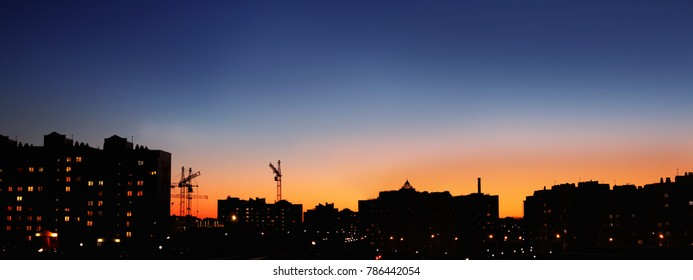 The city lights at night. Panoramic image of the city at sunset.