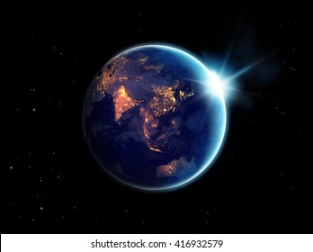 City lights at night in planet earth with sun rising, Elements of this image furnished by NASA