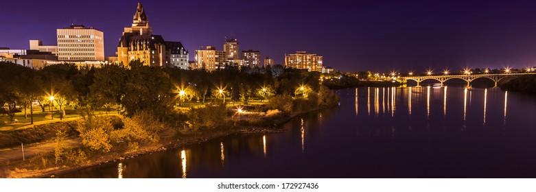 The city lights of Saskatoon at night along the South Saskatchewan River