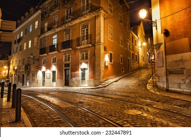 City of Lisbon in Portugal at night, Largo Santa Luzia street with tramline of the famous tram 28.