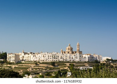The City of Locorotondo, in Italy, on Blue Clean Sky Background. Copy Space