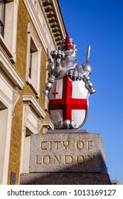 City of London boundary marker with dragon supporter holds the shield of arms