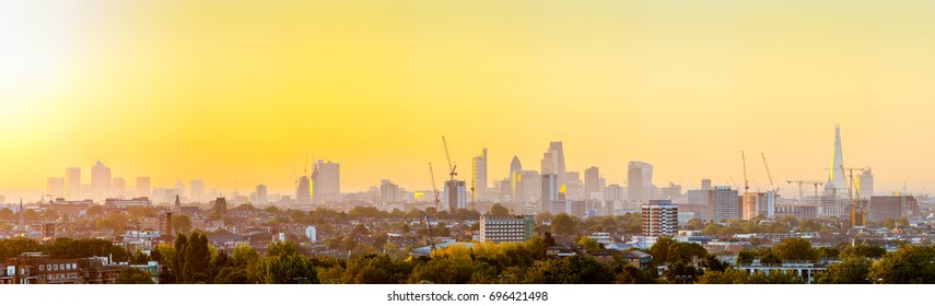 The City of London Cityscape at Sunrise with early Morning Mist from Hampstead Heath.