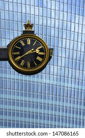 City of London. Clock of St Edmund, King and Martyr with 20 Fenchurch Street behind. 20 Fenchurch Street has been nicknamed the Walkie-Talkie and the Pint due to the distinctive shape of the building.