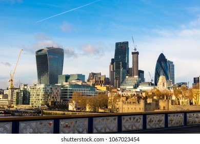 City of London, Financial Services Companies headquarters, The Leadenhall Building, The Gherkin view from south side over Tower Bridge and Tower Hill in golden hour time. London, UK, 11 December 2016