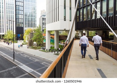 In the city of London office workers walk along a new section of the elevated walkway or so called pedway that was constructed in 2017 along and above London Wall road and Tower Of St Elsyng Spital