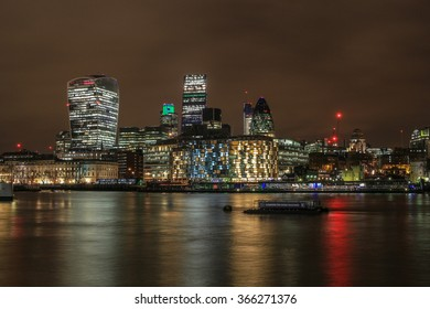 City of London skyline and the river Thames at night.