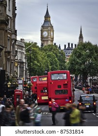 City of  London, View from Trafalgar Square: Big Ben, double deckers, red phonebox, taxi cab, people.
