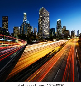 City of Los Angeles California at sunset with light trails.