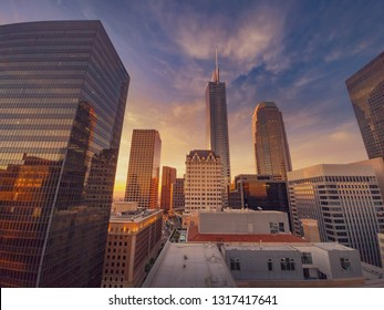 City of Los Angeles at sunset, downtown buildings skyline. Wide angle shot.
