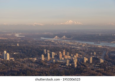 The City of Lougheed Shopping Centre in Burnaby, Greater Vancouver, British Columbia, Canada. Aerial View from Airplane. Port Mann Bridge and Mnt Baker in background.