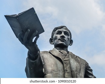 City of Manila, October 4, 2014:  a statue Jose Rizal holding a book