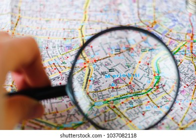 city map through a magnifying glass