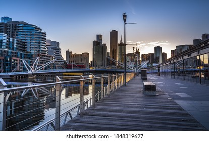 city Melbourne sunrise docklands south wharf wooden deck reflections