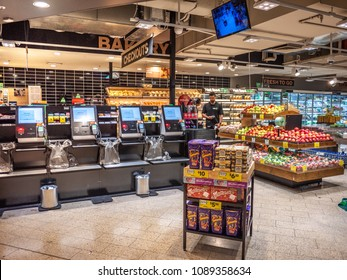 City of Melbourne, VIC/Australia-May 13th 2018:  self check-out machines in   Woolworths Metro supermarket.
