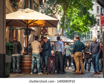 City of Melbourne, VIC/Australia-May 17th 2019: crowds of men drinking and talking outside a tavern in CBD.