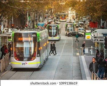 City of Melbourne, VIC/Australia-May 25th 2018: tram arrives at a stop on Bourke street.