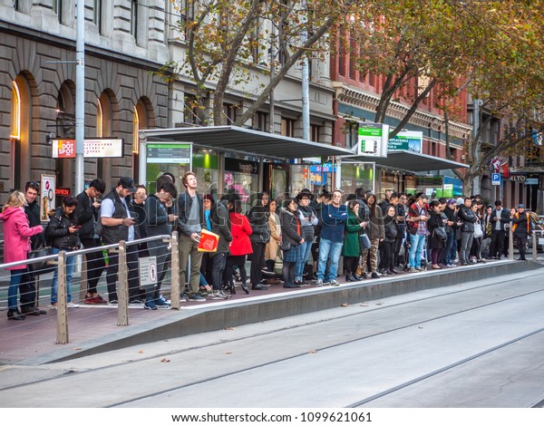 City of Melbourne, VIC/Australia-May 25th 2018: crowds of people waiting at tram stop.