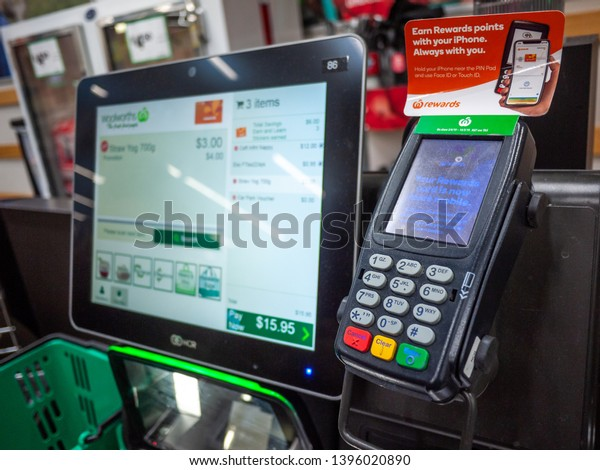 City of Melbourne, VIC/Australia-May 3rd 2019: A POS machine at Woolworths Supermarket's self-serve checkout area.
