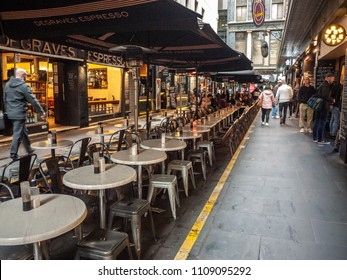 City of Melbourne,VIC/Australia-June 9th 2018: Dinning tables and seats at Degraves Street -- one of the city's most popular tourist spots. It features numerous bars, shops, cafes and restaurants.