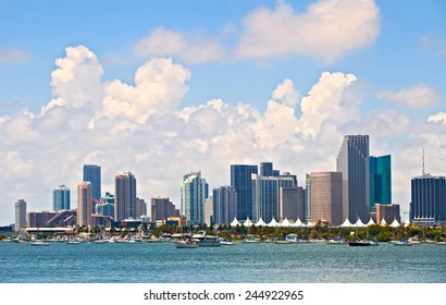 City of Miami Florida, summer panorama of downtown buildings on a beautiful day with blue sky and Biscayne Bay