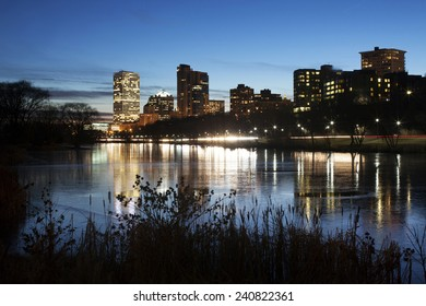City of Milwaukee skyline at dusk. Reflections of the cities lights in water.