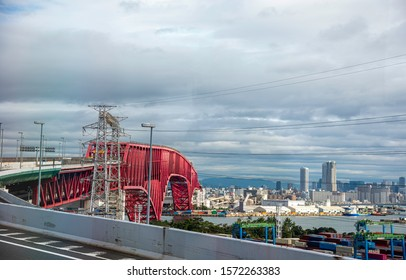 The city and  Minato Bridge is a double-deck cantilever truss bridge in Osaka, Japan
