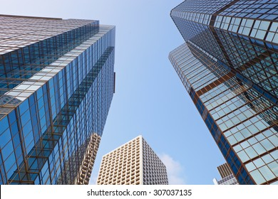 City modern architecture in perspective, tall buildings with sky